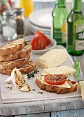 Grilled bread with cheese, garlic and tomatoes
