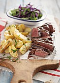 Grilled venison steak with potatoes