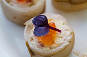 Spicy rolls with fish, salmon caviar and decorative flowers