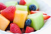 Colourful fruit salad with strawberries and blueberries