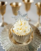 A festive Christmas cupcake with a silver fondant snowflake