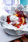 Grilled fruit with marshmallows in aluminium foil