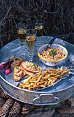 Fried smelts, spreads and wine on a tray