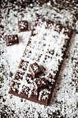 A bar of dark chocolate sprinkled with sea salt