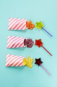 Fruit-flavoured, star-shaped lollies with bags of rock candy for dipping