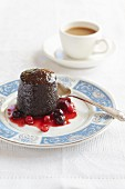 Sticky toffee pudding with a blackberries and redcurrant sauce