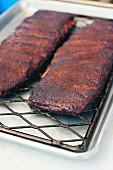 Grilled pork ribs on a metal rack
