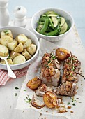 Pork with peaches, potatoes and a side of vegetables