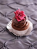 A Valentines cupcake decorated with a sugar rose