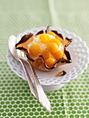 Physalis tartlet with a chocolate edge