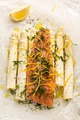 Alpine salmon with lemon zest, fleur de sel, pepper, olive oil and dill on white asparagus in parchment paper (for grilling)