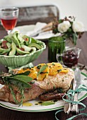Roast duck with oranges and avocado salad