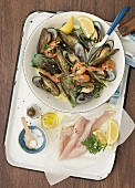 Steamed mussels and prawns, fresh fish fillet, spices and lemons