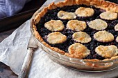 A mulberry pie topped with biscuits