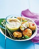 Prawn and coconut cakes with a peanut dip