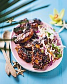 Spicy pork ribs with a coconut and cabbage salad