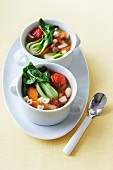 Minestrone with carrots, bok choy, grape tomatoes and tubetti pasta in two soup cups