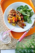 Grilled chicken breast with diced pepper and salad