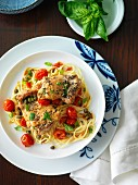 Herb chicken with cherry tomatoes and basil on spaghetti