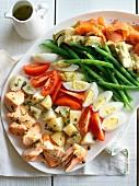 Salad Niçoise with vegetables, salmon and egg