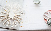 A wire rack and crockery on a white tablecloth