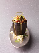 An aubergine filled with pilau rice (vegetarian)