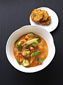 Vegetarian Brussels sprouts curry with rice cakes