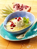 Pineapple soup with coconut ice cream and pomegranate seeds