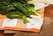 Chard leaves on a checked tea towel