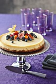 Berry cheesecake on a silver cake stand