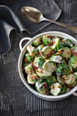 Brussels sprouts with a creamy sauce, pine nuts and Parma ham