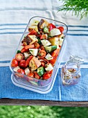 Tuscan salad with bread, tomatoes, cucumber, mozzarella and fresh herbs