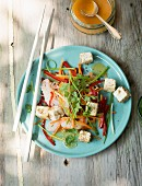 Tofu and vegetable salad on a garden table
