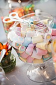 A jar of colourful marshmallows