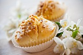 Muffins with chopped almonds and apricot hearts