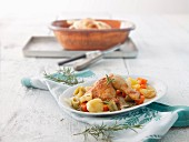 Roast chicken in a terracotta baking dish