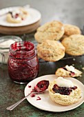Scones with cottage cream and berry jam