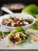 Mixed leaf salad with smoked chicken, strawberries and Camembert in a salad bowl