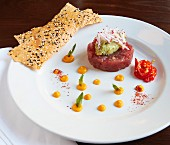 Ahi tuna fish tatar with avocado, chilli, mango sauce and sesame lavash