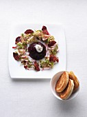 Mini beetroot aspic with beetroot crisps and a salad garnish