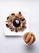 Mini beetroot aspic with beetroot crisps and a salad garnish