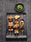Grilled vegan vegetable skewers with green ketchup