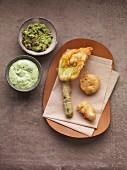 Vegetable tempura with an avocado dip and green sauce