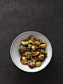 Thai-style Brussels sprouts salad with cranberries and a vinaigrette made from ducca, chilli and ginger