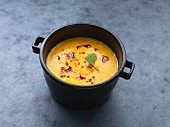 Vegan sweet potato soup with chilli and pumpkin seed oil