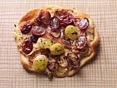 Vegetarian tarte flambée with sauerkraut and grapes