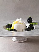 Buttermilk mousse on a blackberry and basil salad