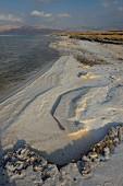 The salt crust on the Dead Sea near Massada