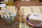 Chopsticks, wooden forks and napkins in a fast food shop