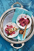 Marinated and grilled halloumi on a beetroot salad with pine nuts